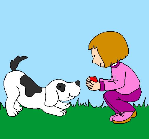 Menina e cão a brincar