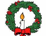 Coroa de natal e uma vela